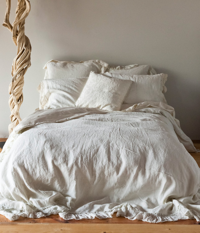 A comforter cover is a great way to experiment with your bedroom color scheme. Coordinate bedding in a cool-toned room with a pure white or sky blue cover. The soft color inspires tranquility while blending beautifully with pastel sheets and throw pillows.